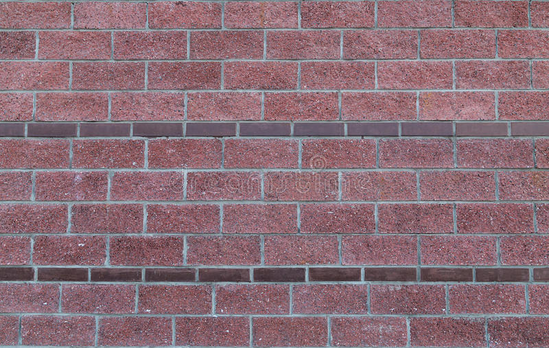 Brick red background with borders of narrow rectangular stone border texture stock images