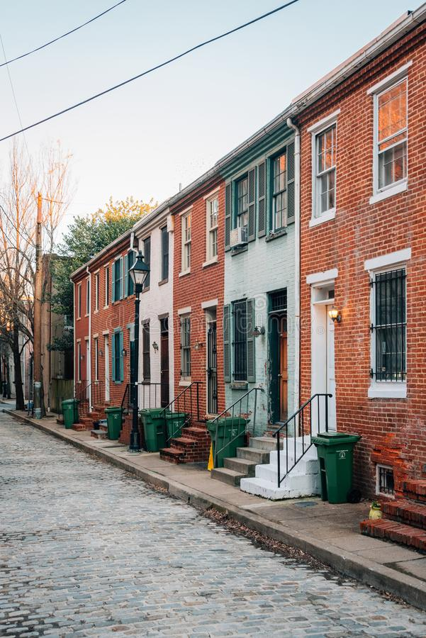 Brick row houses on Dover Street in Ridgely`s Delight, Baltimore, Maryland.  stock photography