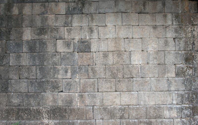 Brick stone gray wall background rough texture stock photo