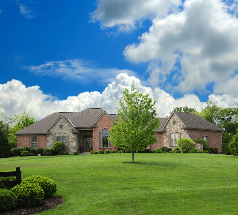 Brick And Stone Suburban Ranch Style Home Stock Image