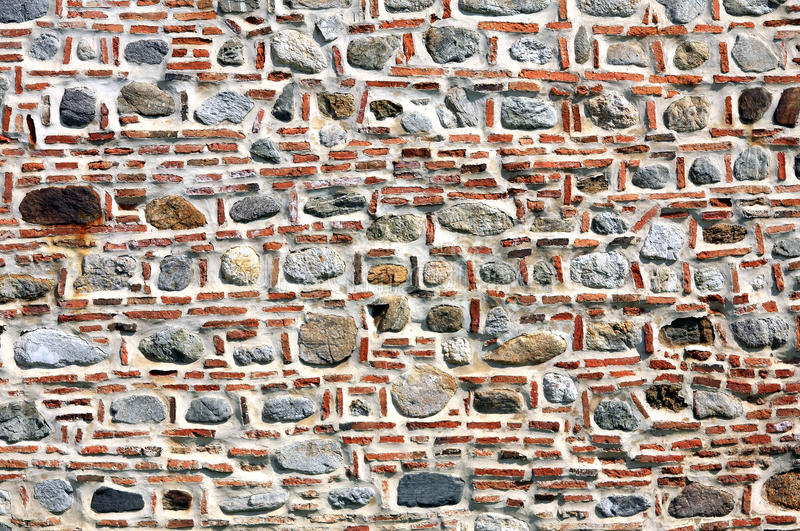 Download Brick and stone wall. stock image. Image of massive, stones - 15831051