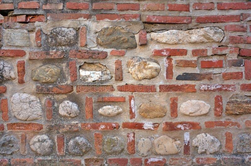 Brick and stone wall. Background stock photo