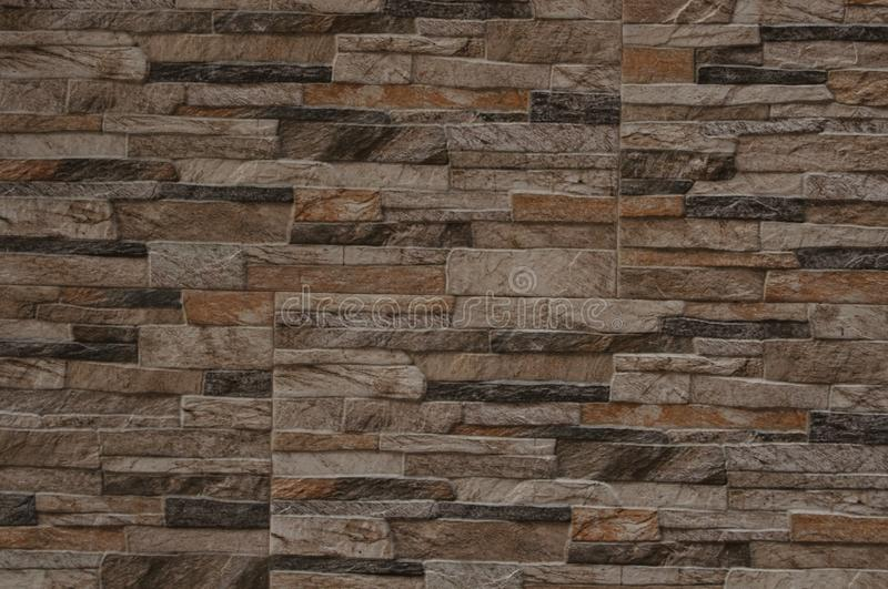 Brick Stone Wall Texture for Background and Design Art Work. Simple grungy stone wall as seamless pattern texture background or as art design overlay. Building stock photo