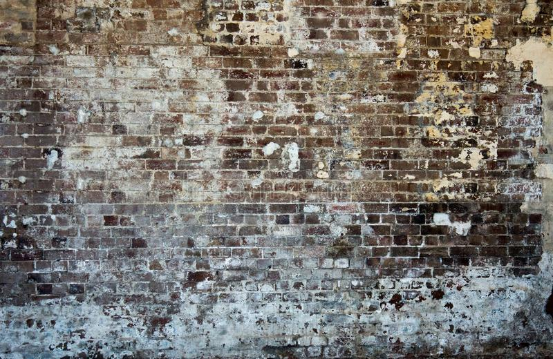 Brick stonewall old worn peeling paint background wallpaper stock images