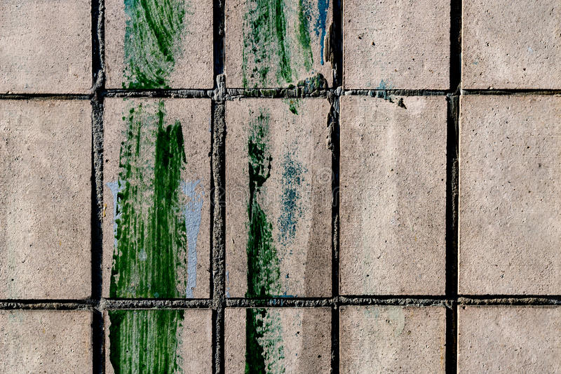 Brick texture with green paint smear. Brick texture with paint smear royalty free stock photography