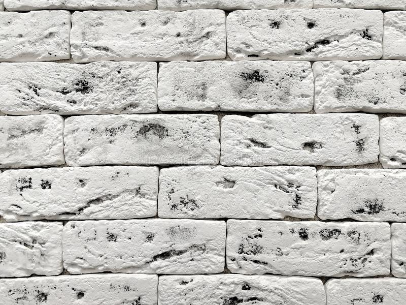 Brick textured background.  White bricks interspersed with black. Front view stock images