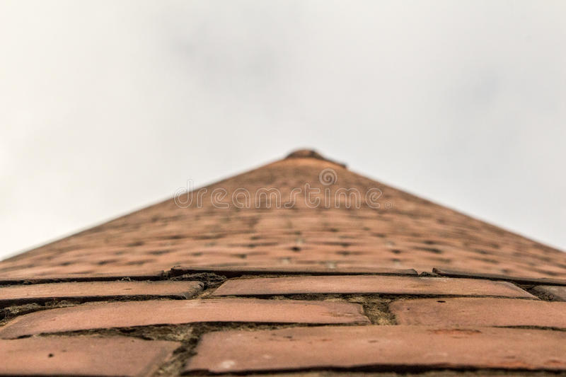 Brick tower bottom view stock images