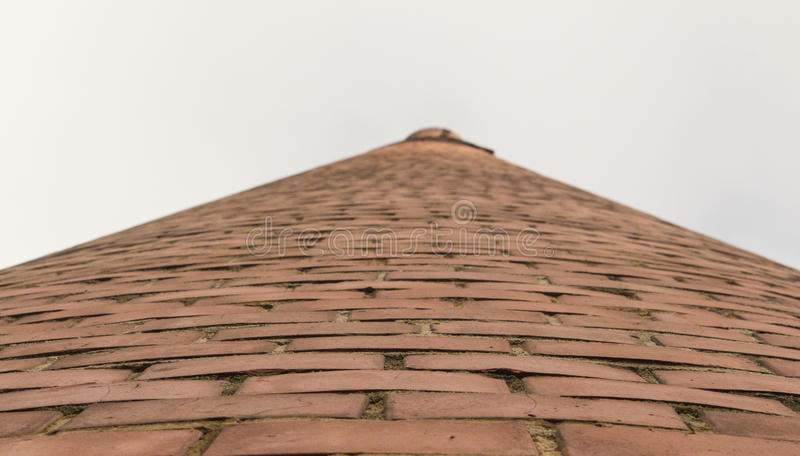 Brick tower in the open sky stock photography