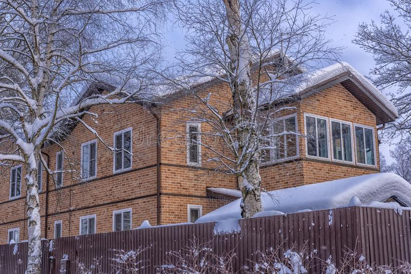 Brick two-storey house in the suburbs in winter. Russia stock photos