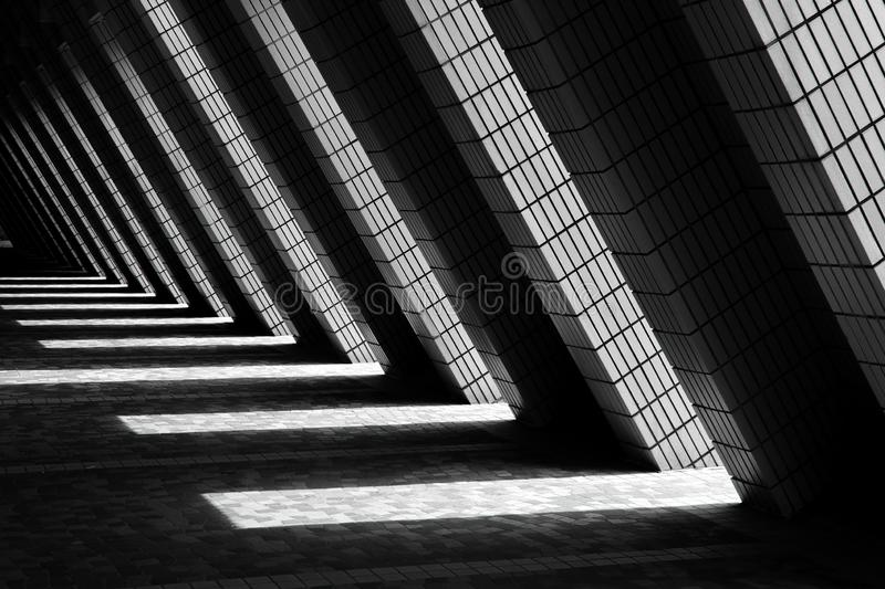 Brick walkway architecture with diagonal beams royalty free stock images