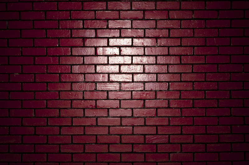 Brick wall. Light irradiation in the red brick wall royalty free stock images