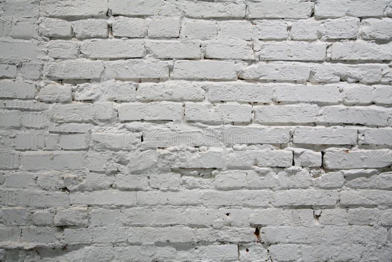 Brick wall. Painted white old brick wall stock photo