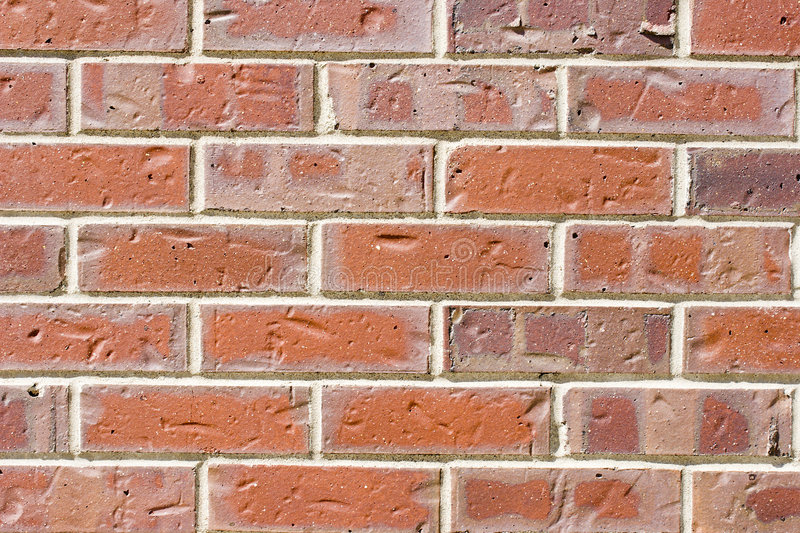 Brick wall. Closeup of red brick wall with mortar