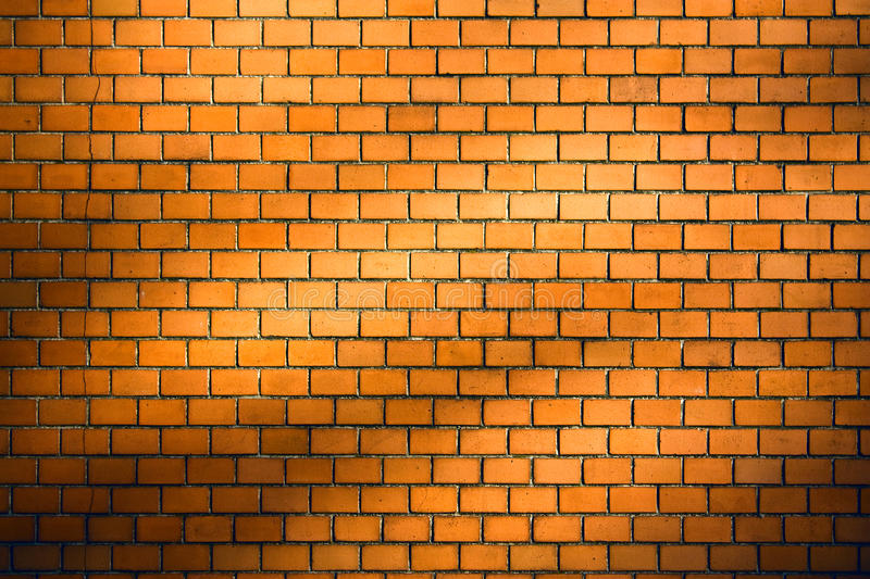 Brick wall background with natural shadow vignette royalty free illustration