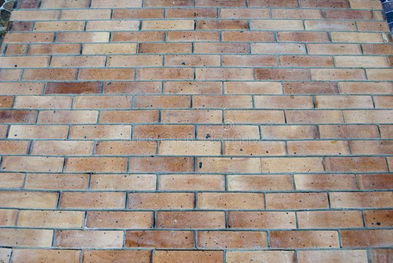 Brick-wall background. Ocher colored wall bricks. Light brown bricked wall texture. Closeup of bricked sand wall. Brick-wall background. Ocher colored wall stock images