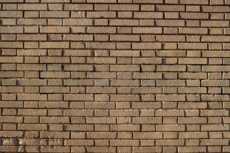 Brick wall background at sunset with sun rays, stone texture.  stock photography