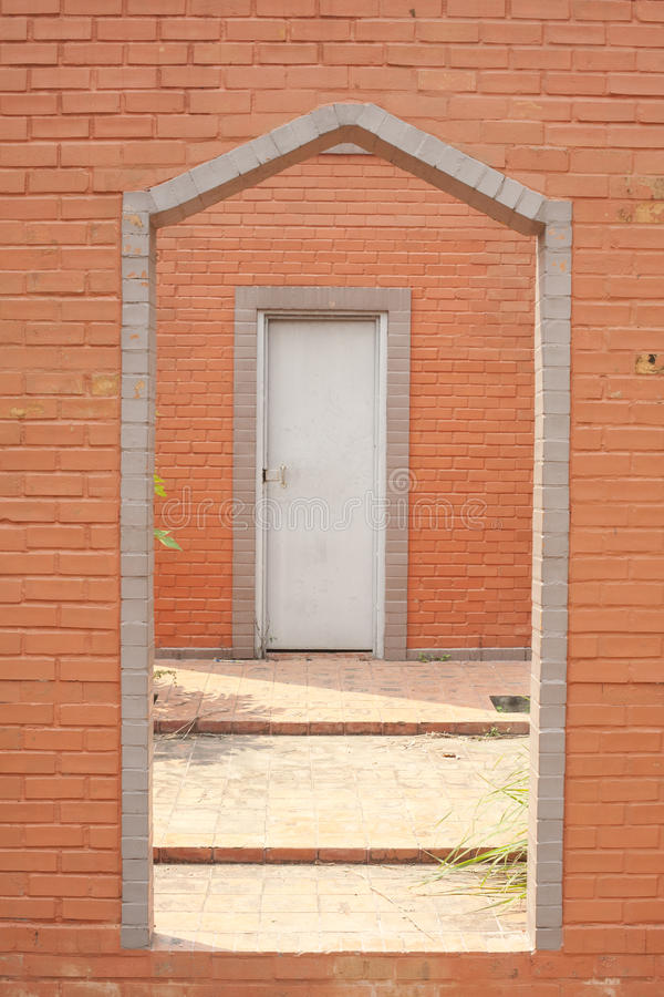 Brick wall \u0026 barred door with detail & Brick wall \u0026 barred door stock photo. Image of grungy - 33980886
