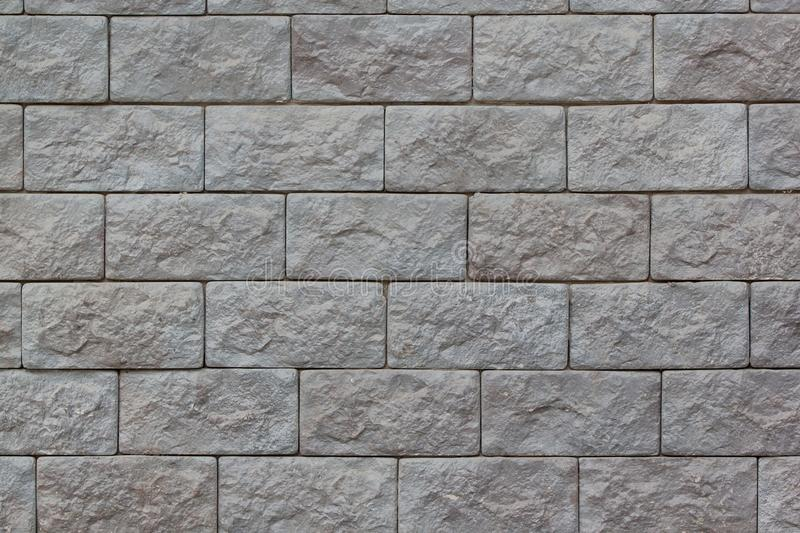 Brick wall with big gray bricks. Used as a background. royalty free stock photography