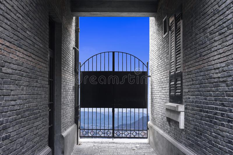 Brick Wall and black steel door close, Blocking freedom chance t. O outside, cityscape background stock image