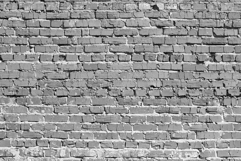 Brick wall. The bricks cracked. Black and white image. Masonry is uneven. royalty free stock photo