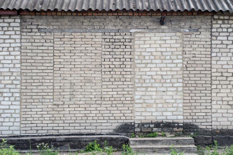 Brick wall with bricks laid down doors and window stock photos