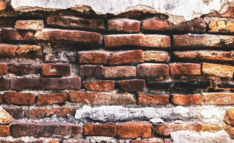A brick wall or brickwork texture background. its decayed with age. Red brick is used to create a house or wall making stock photography