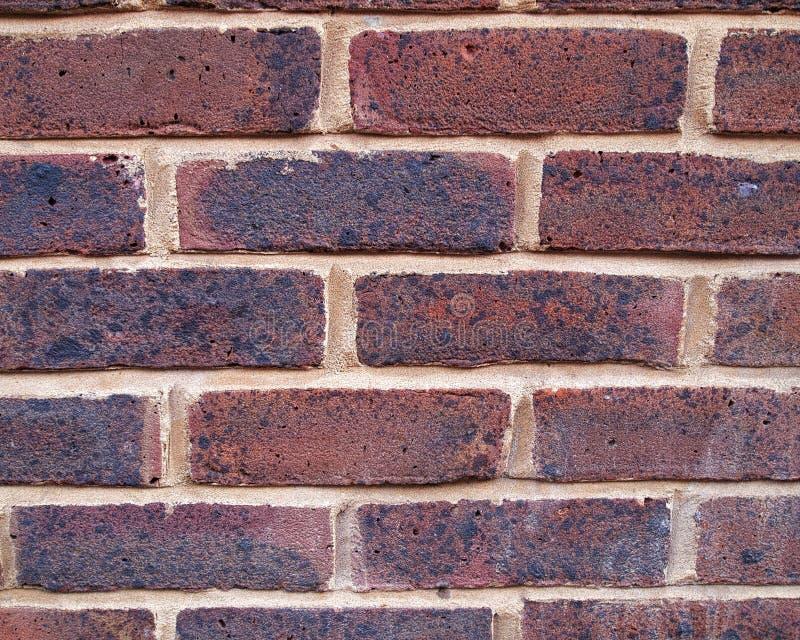 Brick wall closeup bordeaux background. Grunge brick wall closeup bordeaux background stock photography