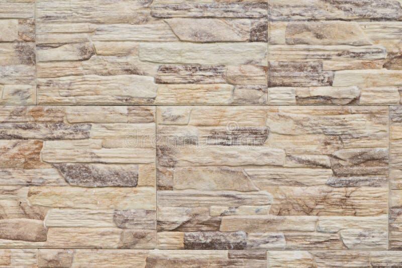 Brick wall closeup photo texture. Natural stone exterior decor. Yellow stone brick surface of modern house. Building architecture design. Stone wall texture stock photo