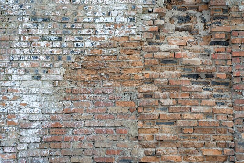 A brick wall collapses under natural conditions, in the open royalty free stock photo