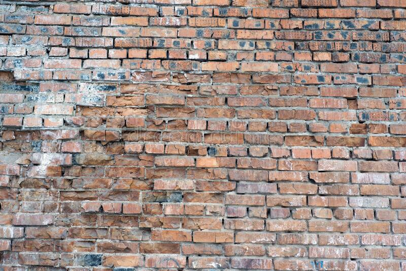 A brick wall collapses under natural conditions, in the open stock images
