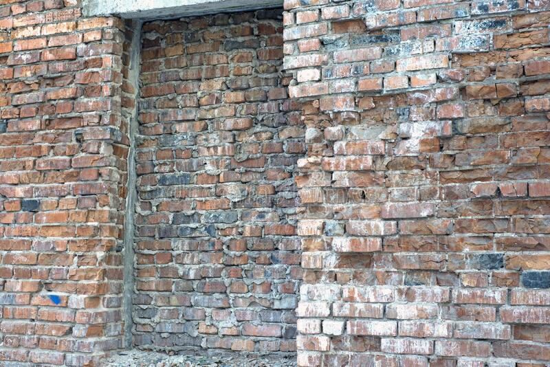 A brick wall collapses under natural conditions, in the open royalty free stock photography