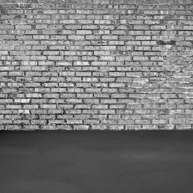 Brick wall and concrete floor. Black and white stock photos