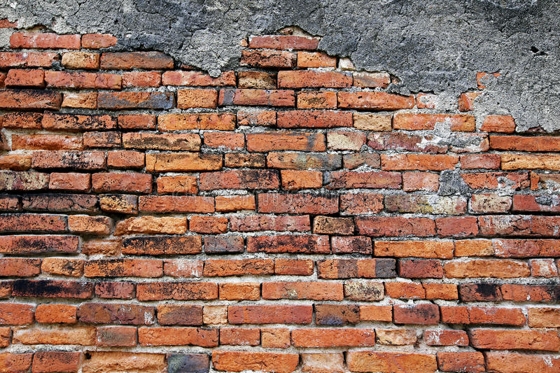 Brick wall. Cracked concrete vintage brick wall background stock photography