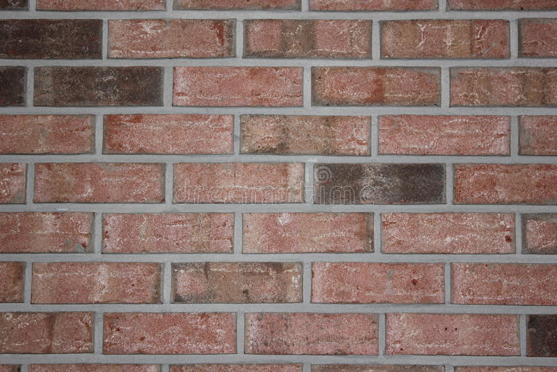 Download Brick Wall With Dark Bricks Stock Image