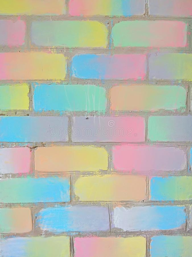 Brick wall decorated with colored chalk, gradient, background royalty free stock images