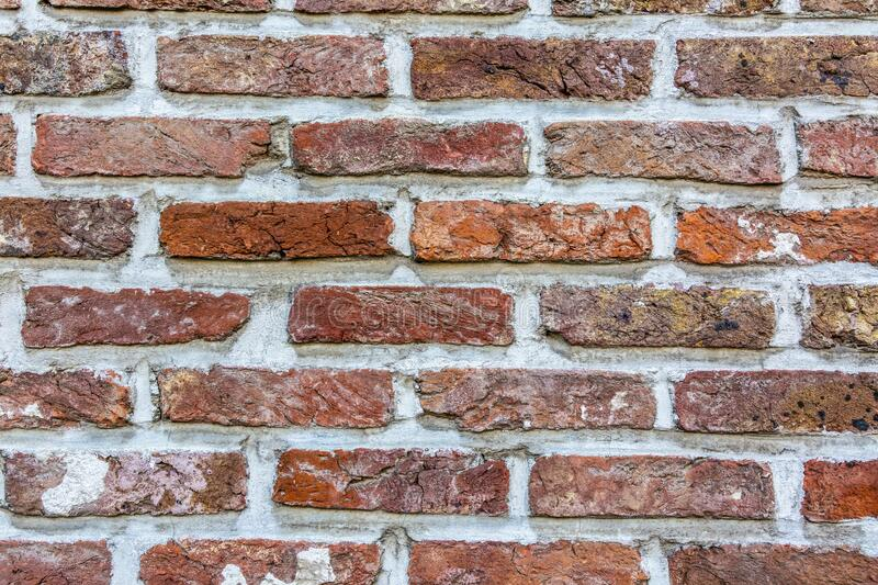 Brick Wall Detail. Close up image of a brick wall with weathered bricks in various colors stock photo