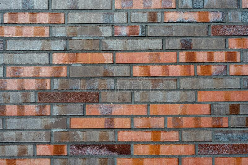 Brick wall with different shades of red royalty free stock image