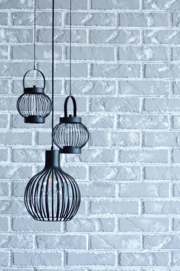 Brick wall empty interior decoration modern lamp concept, decorative and grey background for home office.  stock image
