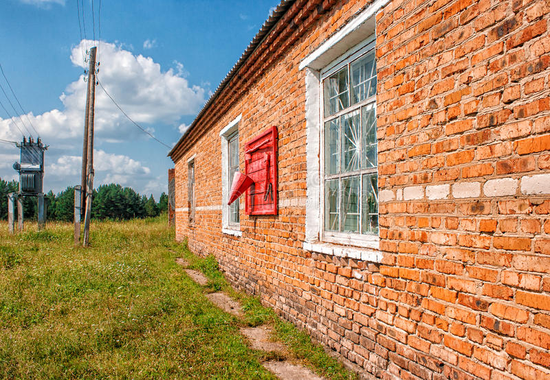 Brick wall with a fire shield. Brick wall of the house with a fire shield on summer day stock image