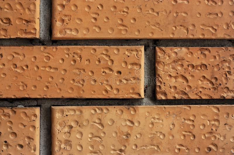 Brick wall fragment. Old dirty orange bricks with defects. Grunge texture with cracks and weathered. Brick wall fragment. Old dirty orange and red bricks with royalty free stock photo