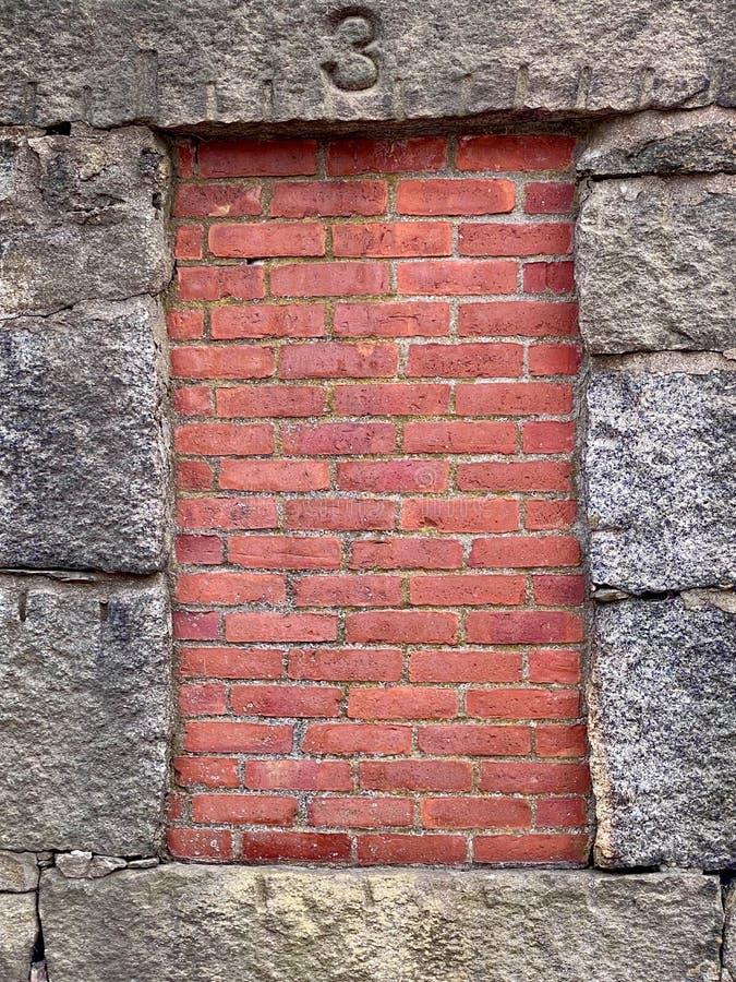 Brick Wall inset in Stone stock photo