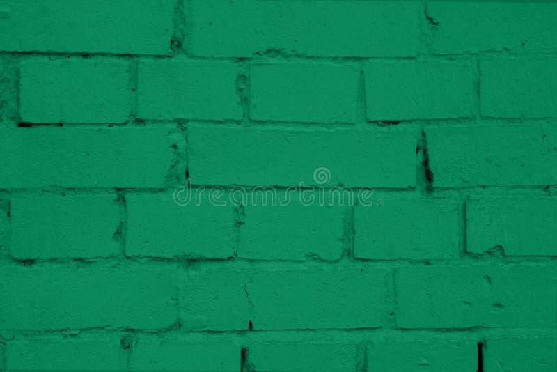 Brick wall of green painted brick. Green brick wall texture. Old brickwork. Mason work royalty free stock photography