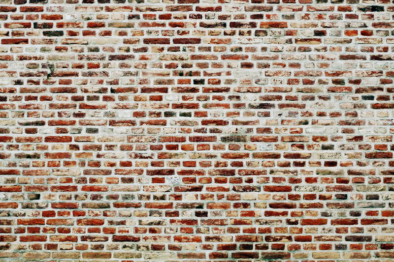 Brick wall horizontal background with red, orange and brown bricks - contrast version. Brick wall horizontal background consisting of red, orange and brown stock photo