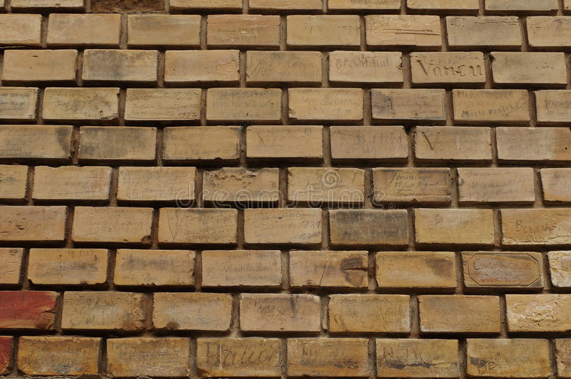 Brick background. Brick wall with inscriptions of the last century - Baile Herculane, landmark attraction in Romania royalty free stock images