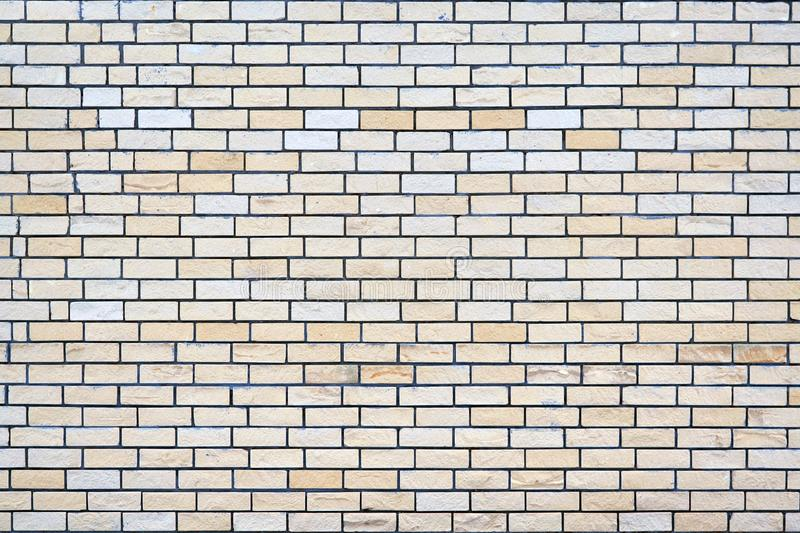 Brick wall of light beige and yellow brick. royalty free stock images