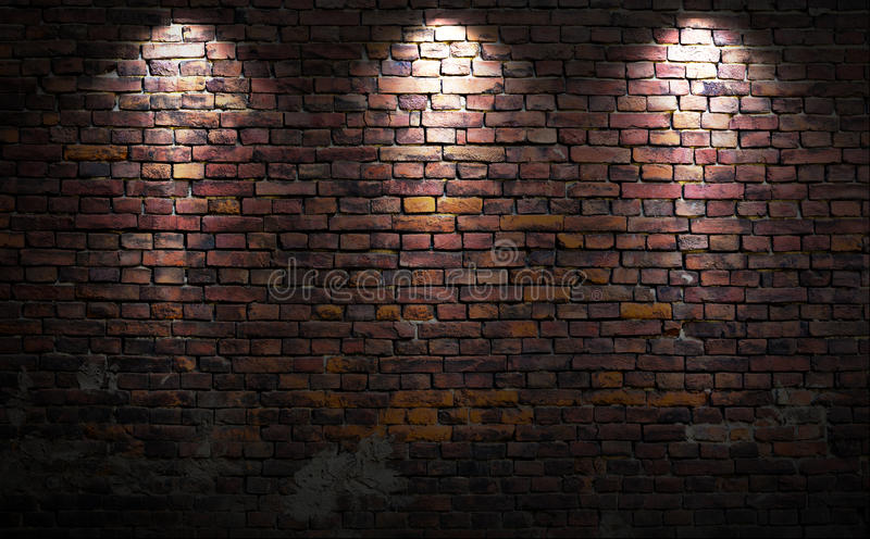 Brick wall with lights stock image