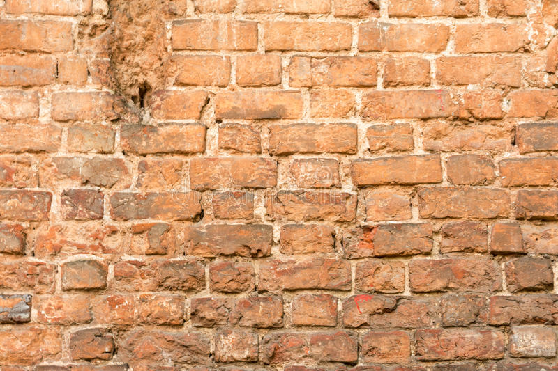 Brick wall made of red stone stock photos