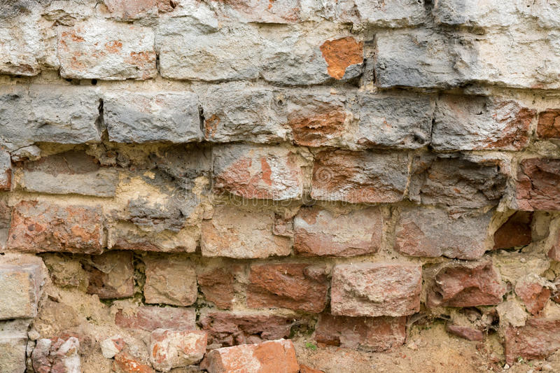 Brick wall made of red stone stock photo