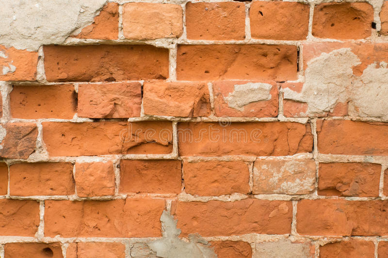Brick wall made of red stone stock image