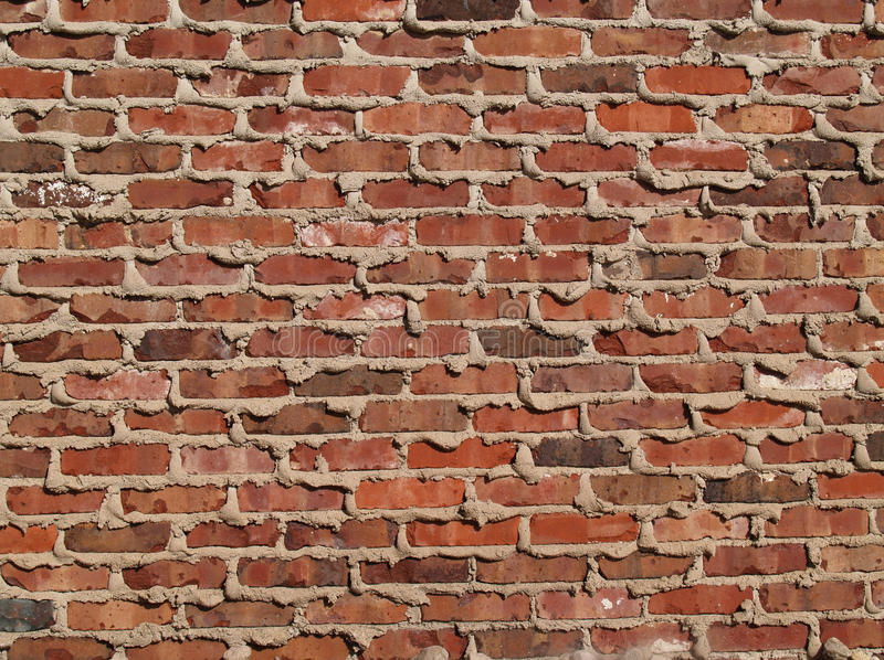 Brick Wall With Mortar Oozing From the Cracks stock image